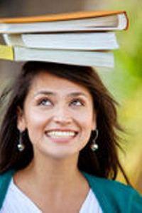 student-balancing-books-16137452